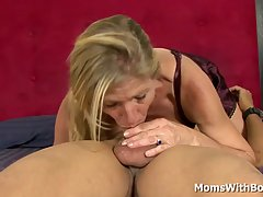 Blonde mature woman is sucking a young guy's hard dick, whil...