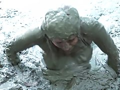 Naughty babe with pink hair and big, bouncy tits likes a mud...