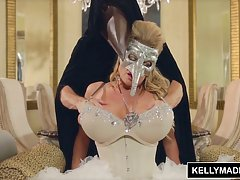 Blonde with a mask, Kelly Madison is rubbing her tits, while...