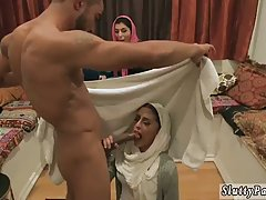 Arabic teen whores are wearing their head scarfs while satisfying a horny guy who has hired them