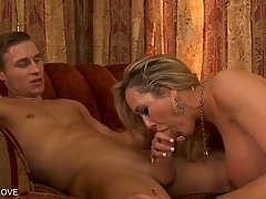 Amazing blonde woman with ample breasts licks and sucks dick...