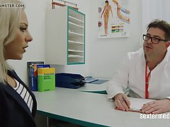 German blonde likes the way her doctor is rubbing her soaking wet pussy, in his office