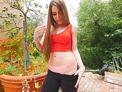 Красивая подружка в саду показывает свои трусики и большие с...