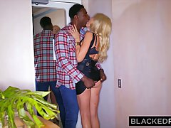 Gorgeous blonde, Barbie Doll Riley is having wild sex with a black dude and enjoying it