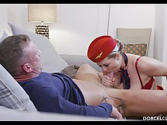 Super sexy stewardess is kneeling in front of a handsome man...