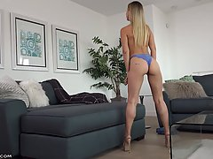 Petite blonde cock teaser is slowly taking off her clothes, ...