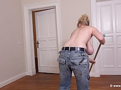 Busty blonde woman, Casey is cleaning the house and playing ...
