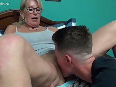 Big titted, blonde woman is having hardcore sex with a young...