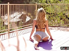 Blonde woman was done with her yoga routine for the day, so ...