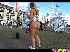 Blonde chick with a big, round butt is partying during a fes...