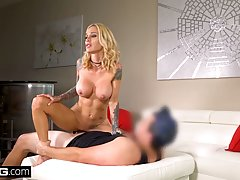 Sexy blonde woman with big tits and tattoos is about to get ...