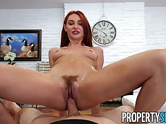 Red haired darling is riding a stiff dick in the middle of t...