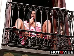 Horny brunette is masturbating and squirting on the balcony,...