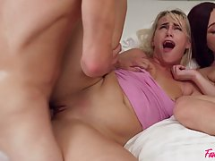 Two girls and two guys are fucking in the bedroom, in the mi...