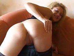 Lusty German blonde in erotic, black stockings is spreading ...