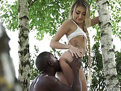 Slender babe and a black guy went to a local forest to make ...